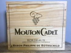 Baron Philippe de Rothschild Mouton Cadet Bordeaux 2002 Three bottles, in old wooden case, unopened.