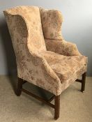 A late George III mahogany framed wing armchair Later upholstered and with cushion seat.