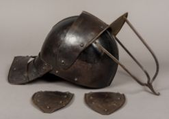 A 17th century English Civil war tri-bar lobster pot helmet The two piece skull with raised medial