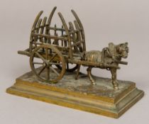 A 19th century bronze group of a horse and hay cart Naturalistically modelled,