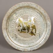 An Eastern white metal tray Worked with a figure riding a camel with gilt highlights within Arabic