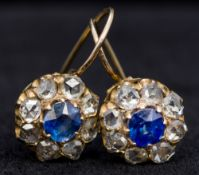 A pair of unmarked gold, diamond and sapphire earrings Each of target form,