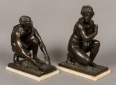 A pair of 19th century patinated bronze classical figures Each crouching, one male,