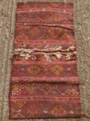 A Caucasian wool saddle bag rug Decorated with latch hook lozenges. 124 x 67 cm.