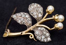 An unmarked gold, diamond and pearl set brooch Of floral spray form. 3.75 cm wide.