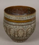 A 19th century Indian silver and copper vase Typically worked with various deities within lappet