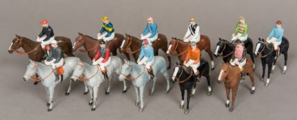 Eleven Britains Ltd painted lead horses and jockeys Painted in various owners' colours. 10 cm high.