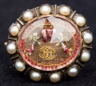 A rare 17th century enamel decorated pearl and Stuart Crystal set brooch Of domed oval form centred