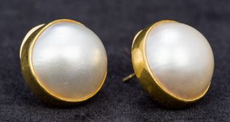 A pair of hand made 18 ct yellow gold stud earrings,