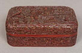 A Chinese cinnabar lacquer box and cover Extensively worked with figures within a mountainous