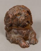 A Black Forest carved wooden inkwell Formed as a dog, the hinged head with glass inset eyes,