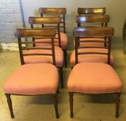 A set of six 19th century mahogany dining chairs Each with a moulded curved top rail above the