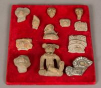 A collection of twelve small South American antiquity fragments and pieces Various designs and