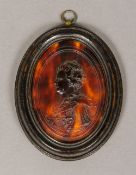 An early 18th century pressed tortoiseshell miniature,