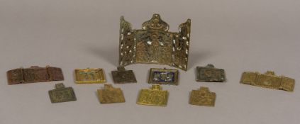 A collection of 19th century brass religious travelling icons Some of triptych form.