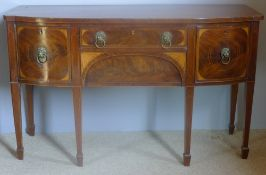 A George III mahogany bow front sideboard The line inlaid shaped top above three inlaid drawers and