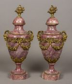A pair of French bronze mounted variegated purple marble urns Each with twin horned mask handles