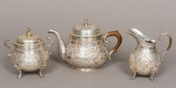 A Persian silver three piece tea set,
