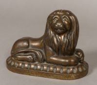 A 19th century cast iron doorstop Modelled as a recumbent lion with allover bronzed finish.
