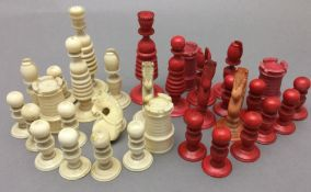A 19th century carved and stained ivory chess set The King 9.5 cm high.
