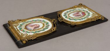 A 19th century ormolu and Sevres style painted porcelain mounted book slide Each end panel painted