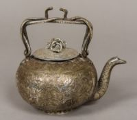 A 19th century Indian silver plated teapot With entwined snake handle and removable lid,