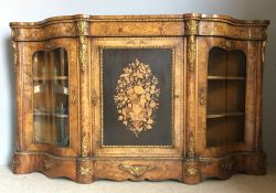 A Victorian marquetry inlaid and ormolu mounted burr walnut credenza The shaped top above the twin