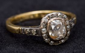 An antique 18 ct gold diamond ring The central stone approximately 0.