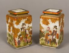 A pair of small Japanese Satsuma vases Each of square section form, decorated with various figures,
