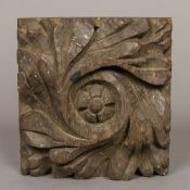A carved oak roof boss, possibly 18th century 22 cm wide.
