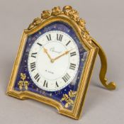 A Swiss gilt bronze cased desk timepiece The 2 1/2 inch white and blue enamelled dial with Roman