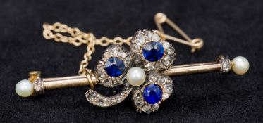 An unmarked gold, diamond, sapphire and seed pearl bar brooch Centrally set with a trefoil. 4.