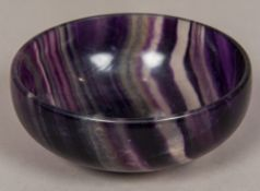 A Florspar type mineral bowl Of simple dished form, with a low foot. 15.5 cm diameter.