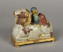 A Chinese cloisonne group Worked as a figure reclining on a recumbent ram,