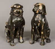 A pair of 19th century Chinese lacquered dogs-of-fo Each typically modelled seated. Each 27.