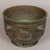 A 19th century Oriental bronze jardiniere Finely cast and hand worked with four mythical beast