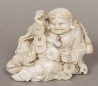 A Chinese carved Shoushan stone figure of Liu Hai Worked recumbent with three legged toad and