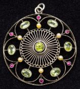 An unmarked 14 ct white gold Suffragette pendant Of pierced circular form, set with peridot,
