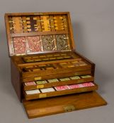 A Victorian walnut cased games compendium The hinged rectangular lid with vacant brass cartouche,