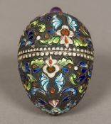 A Russian enamel decorated silver box of egg form,