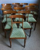 A set of fourteen Victorian mahogany dining chairs,