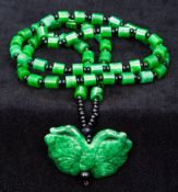 A Chinese carved spinach jade bead necklace With carved butterfly pendant. The pendant 4.