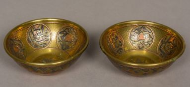 A pair of 19th century Cairoware bowls Each decorated to the inside with scrolling and calligraphic