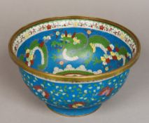 A Chinese cloisonne bowl Typically worked with dragons and lotus strapwork,