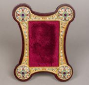 A Russian silver gilt and enamelled bejewelled photograph frame,