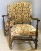 A pair of carved oak open armchairs The arms with acanthus carving,