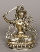 A Chinese silvered figure of Manjushri Typically modelled on a lotus cast base,