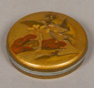 A small Japanese Meiji period lacquered box and cover Of small circular form,