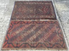 A Caucasian wool rug The wine red field with central pole medallion within geometric motifs,