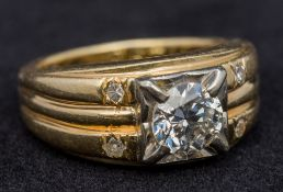 An unmarked gold diamond set ring